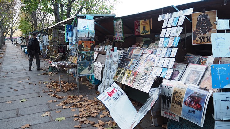 Numerous businesses throughout Paris rely on tourist traffic, such as the age-old stalls along the Seine.