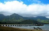 Hanalei Bay is one of Hawaii's most picturesque natural attractions and a popular place for surf lessons, thanks to an often beginner-friendly shore break with a sandy bottom.