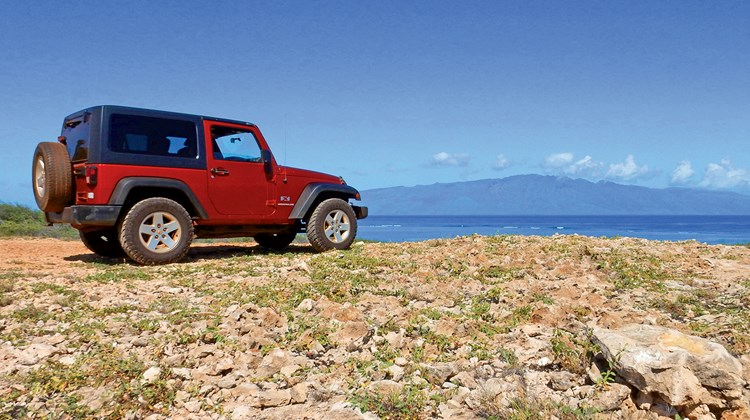 Visitors will find only 30 miles of paved road on Lanai, and the only rental vehicles available are four-wheel-drive jeeps, allowing travelers to explore an array of secluded coastlines that often showcase stunning views of neighbor islands, such as Molokai seen here.
