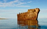 A 30-minute drive north from Lanai City, travelers can access Kaiolohia, or Shipwreck Beach, where the rusting hull of a 1940s oil tanker remains fixed on the coastline's coral reef. Many vessels have run ashore over the years in the region's rocky channel.