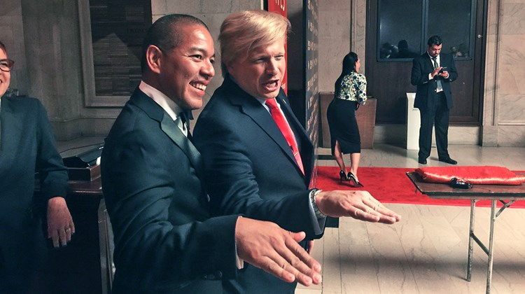 Donald Trump imitator John Di Domenico shows Jorge Vivas, corporate director of sales tour and travel for Palace Resorts, the proper technique for telling someone, ''You're fired.''