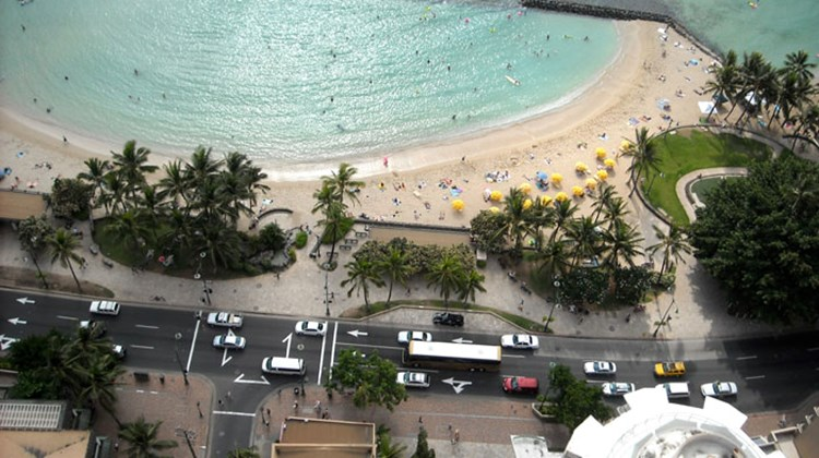 The view of Kalakaua Avenue and part of Kuhio Beach Park from the penthouse floor of the Aston Waikiki Beachside Hotel.