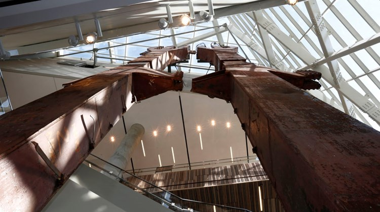 "The 9/11 Memorial and Museum, which opens to the public May 21, will ""display artifacts associated with the events of September 11 while presenting stories of loss and recovery."" A view from below of the steel ""tridents"" in the museum's entry pavilion that formed part of the exterior structural support of the east facade of the North Tower. All photos by Jin Lee/NYC and Company. Caption source: 9/11 Memorial and Museum"