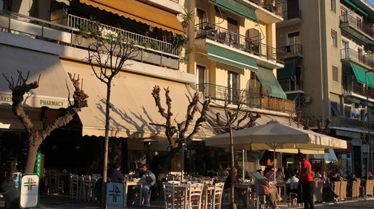 Outdoor cafes attract Greek and foreign customers, but Greeks are less likely to be seen in the cafes during the country's current economic crisis.