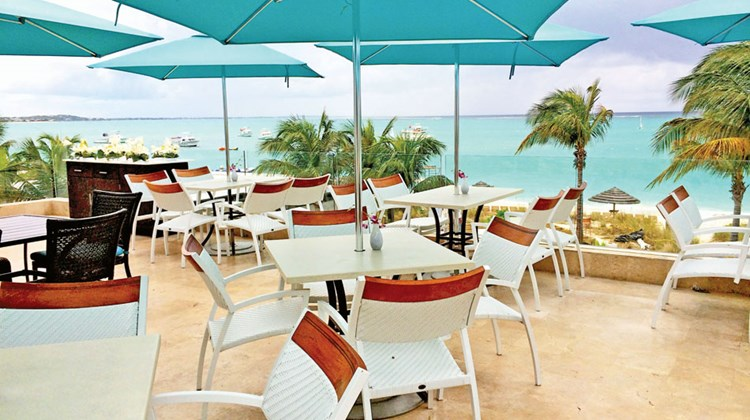 One of the village's three al fresco eateries, Sky Lounge, is located on the roof above Bayside and open for breakfast and dinner, offering Italian and seafood specialties with sweeping views of Grace Bay Beach.