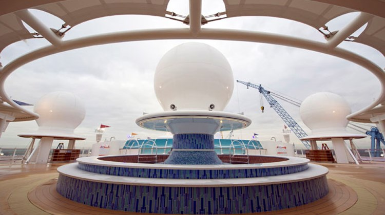 A pool is built around a satellite dome in an adults-only section of the Fantasy.