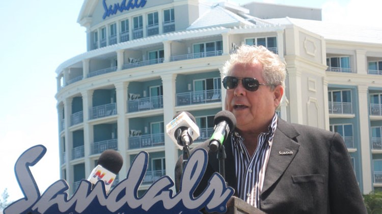 Sandals Chairman Butch Stewart stands in front of the remodeled Balmoral Tower.