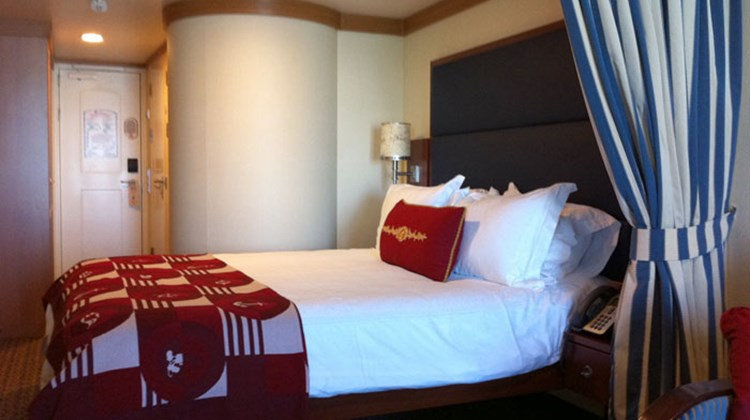 A stateroom in Category 04A, Deck 9, featured a queen bed, pullout couch, desk and balcony.