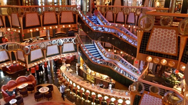 With its Vegas-style decor, the Carnival Splendor's multi-deck atrium is the first space guests see when boarding the ship. Photo by Peter Knego/www.maritimematters.com
