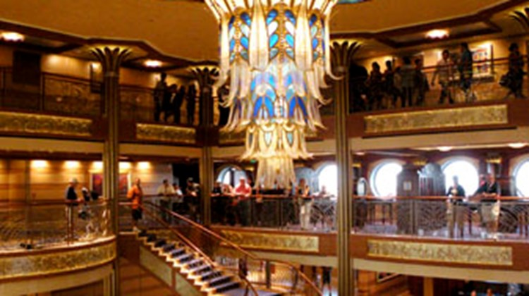 The art deco look and statue of Admiral Donald in the ship's lobby are familiar to past guests.