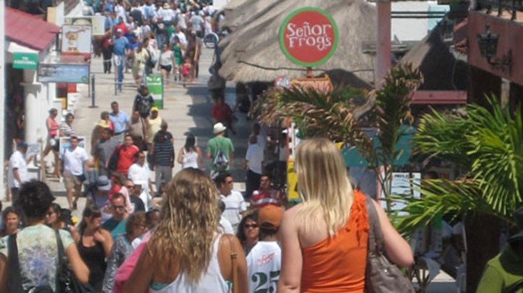Tourists crowd the streets leading from the ferry dock at Playa del Carmen. TW photo by Gay Nagle Myers