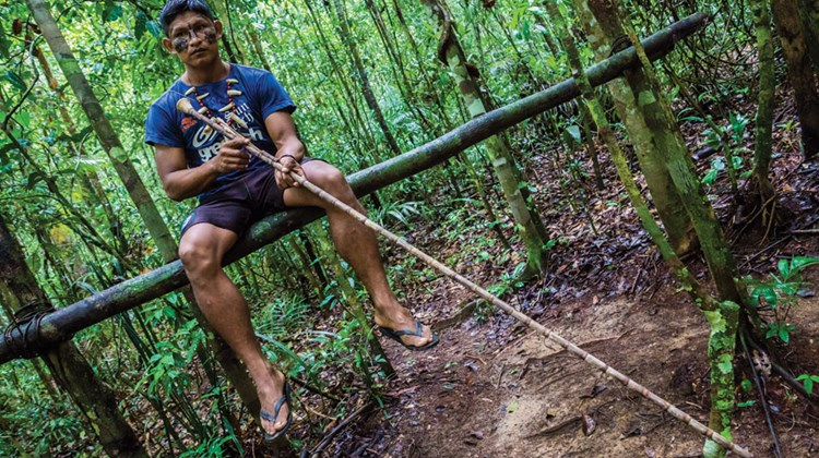 Hooking up with the chief of a local tribe, we got to spring animal traps with curare-tipped arrows and shoot lethal darts from a blowgun.