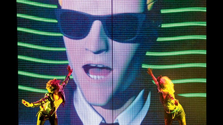 "1980s character Max Headroom on LED screens aboard the Carnival Freedom as part of the ship's ""80s Pop to the Max"" show in the main theater."