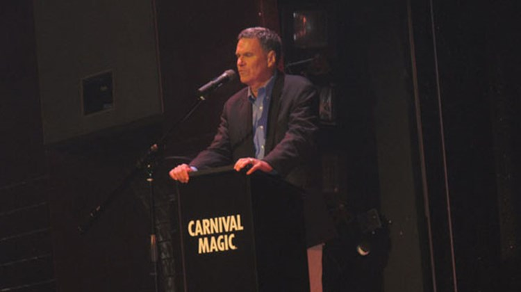 Carnival Cruise Lines President and CEO Gerry Cahill welcomes guests to the naming ceremony for the Carnival Magic in Venice May 1. The ceremony was held in the ship's Showtime Theater.