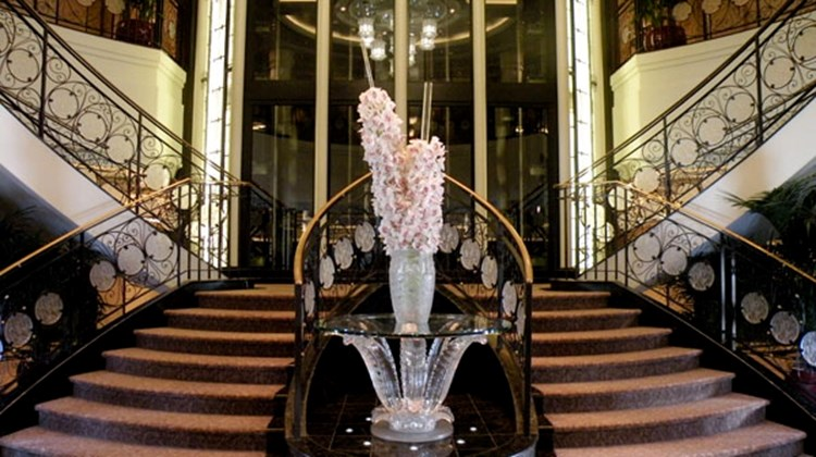 Oceania's signature staircase in its atrium was designed by Lalique for the Marina. TW photo by Johanna Jainchill