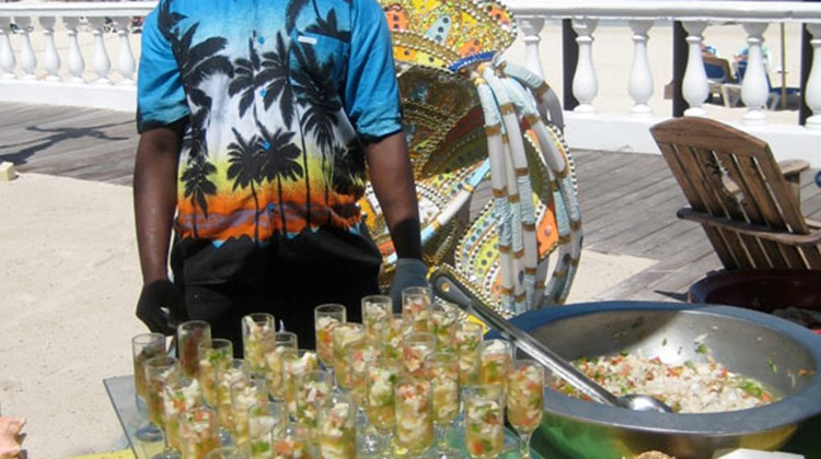 A sampling of conch salad is offered poolside at Sandals Royal Bahamian resort.