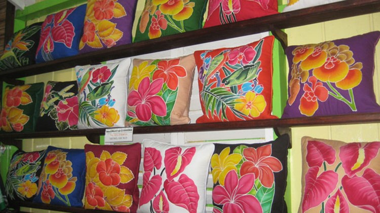 Artisans use wax and dye to create colorful fabrics at Caribelle Batik on St. Kitts.