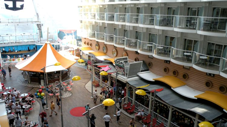 The Boardwalk neighborhood as seen from a Boardwalk balcony cabin, looking out towards the sea and the AquaTheater.