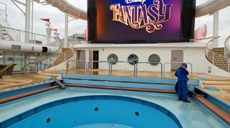 A pool, the big-screen television and part of the water coaster on the Fantasy's pool deck.