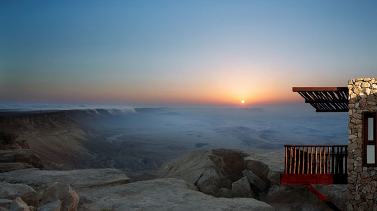 Israel has gone full steam ahead on the modern hospitality and tourism front, with top properties popping up across the country, complemented by unique activities available from Tel Aviv's hip haunts to Jerusalem's Old World wonders and the Sea of Galilee. Pictured here, the view of the 200 million-year-old Makhtesh Ramon Crater from the Beresheet Hotel. The property is located about two-and-a-half hours south of Tel Aviv in the Negev Desert.