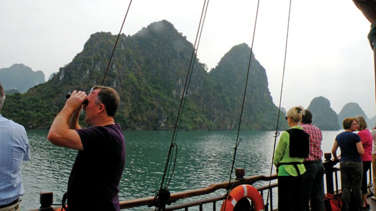 Silver Shadow passengers on a junk in Halong Bay, Vietnam