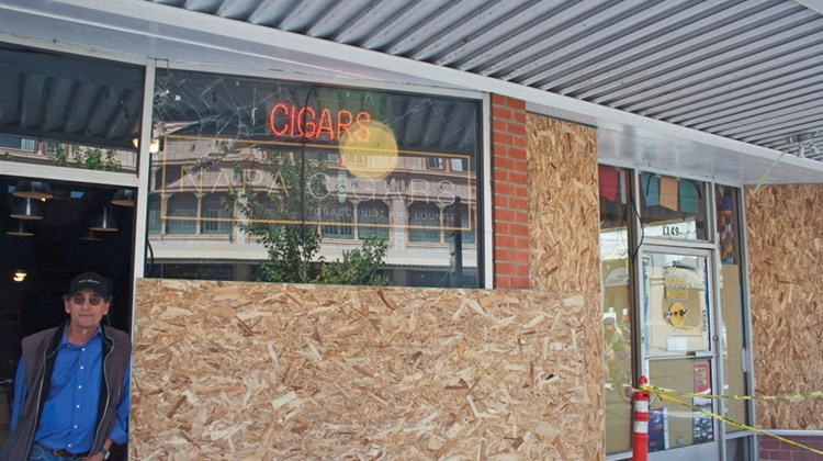 Retail stores such as this cigar shop along Napa's First Street were boarded up and closed on Monday as shop owners assessed the quake damage.