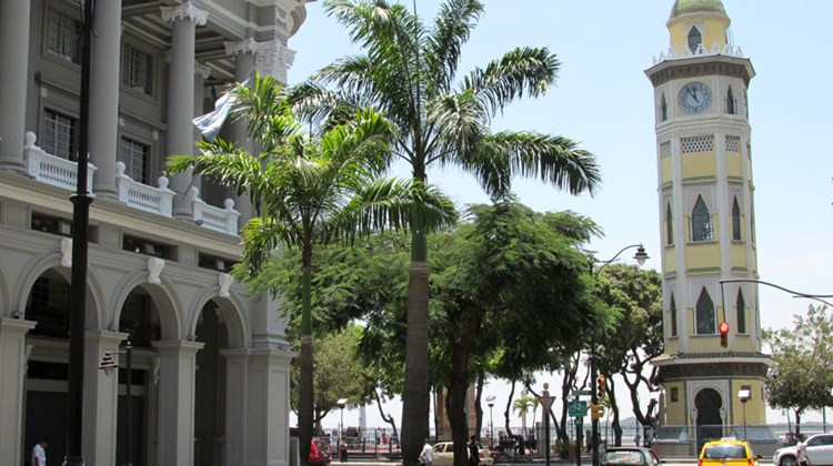 The clock tower on Guayaquil's Malecon 2000 riverfront promenade. At left is Guayaquil's Municipal Palace.