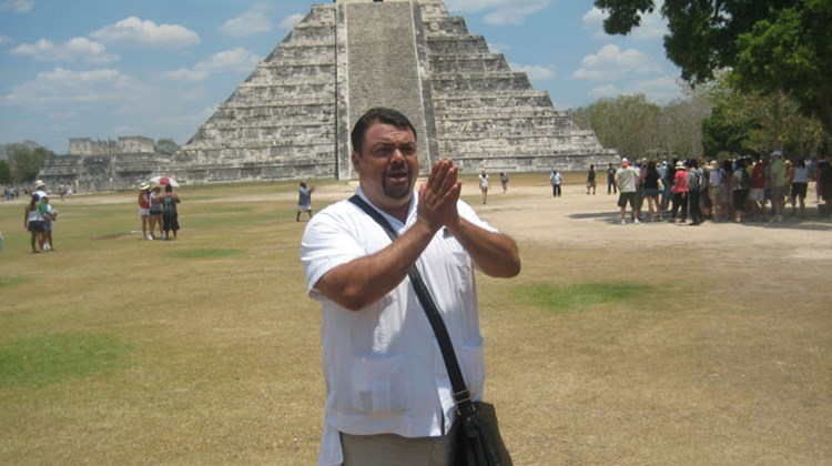 Victor Palacios, guide from Cancun Sightseeing, standing in front of Temple of Warriors at Chichen Itza. TW photo by Gay Nagle Myers