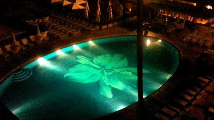 The pool is the focal point of the Halekulani grounds, even at night.