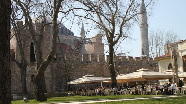 An outdoor cafe in the outermost courtyard at Topkapi Palace, with the Hagia Sophia visible in the background. This courtyard is open at no charge to the public and functions much like a park.