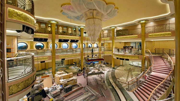 The ship's atrium is filled with scaffolding now, but its first revenue cruise is March 31.