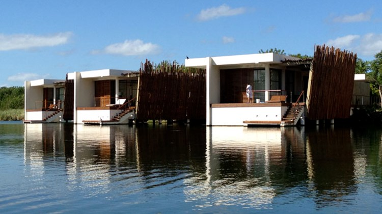 The largest accommodations are the 18 overwater suites that float out over the water's edge where the lagoon widens out.