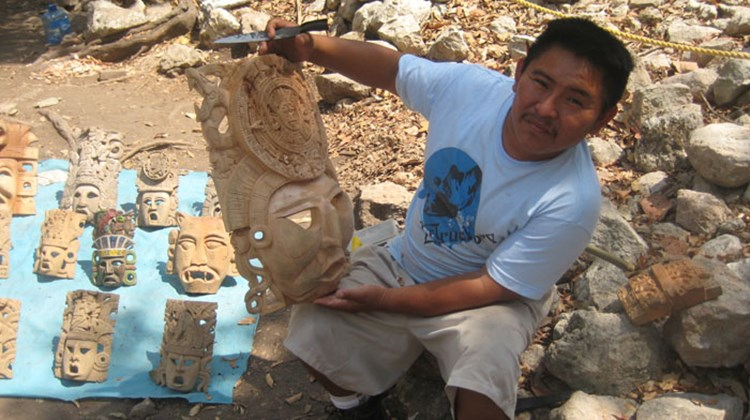 A wood carver at the Chichen Itza souvenir area. TW photo by Gay Nagle Myers