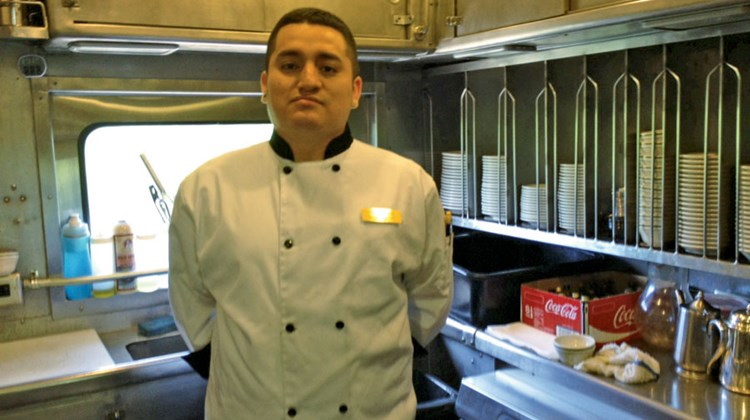 Pullman Rail Journeys' chef Marc Guzman turns out three meals a day in a compact, efficient kitchen.