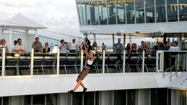 One of the first users to experience the Zip Line ride on the Oasis of the Seas.