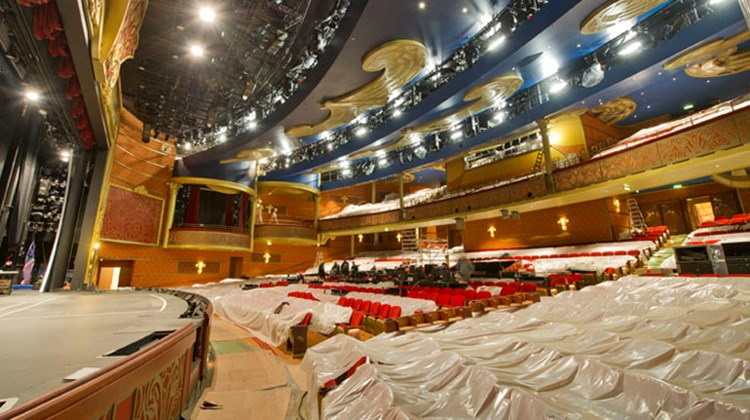 Plastic coverings protect the new seats in the Fantasy's theater. About 2,000 workers are preparing the 2,500-passenger Fantasy for a conveyance from Meyer Werft.