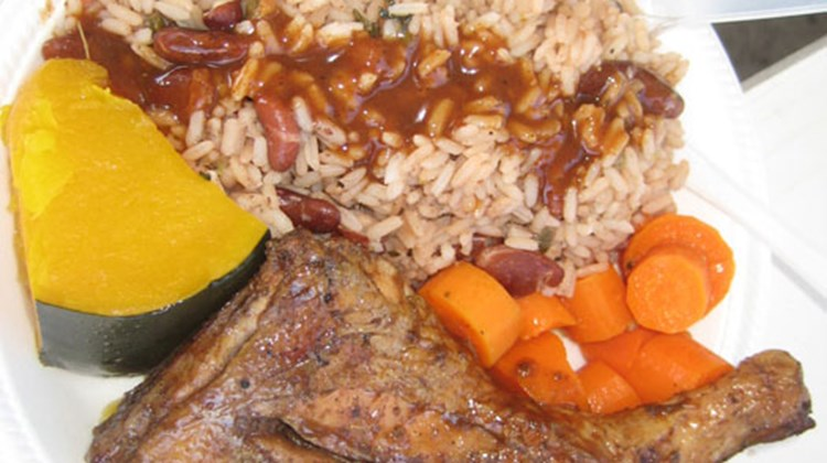 A platter of rice, peas and chicken, accompanied by yams and plantains, is a typical meal served in local restaurants in St. Kitts and Nevis.