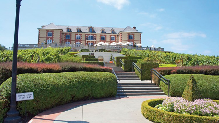 While downtown Napa suffered, the effects were virtually unnoticeable in much of the surrounding vine-covered rolling hills and wineries that Napa Valley and Sonoma are famous for. Pictured here, the Domaine Carneros winery was bustling at lunch time on Monday. TW photos by Michelle Baran; posted Aug. 26, 2014