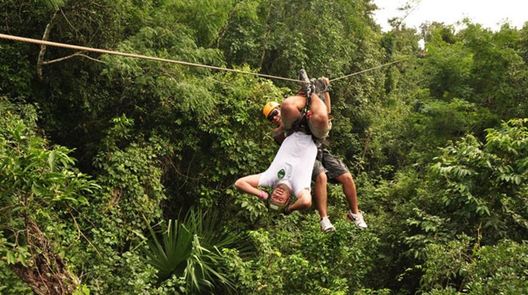 Guides help participants get acrobatic on the zip-line at Selvatica.