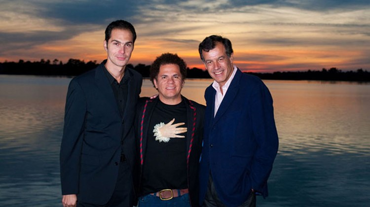 Xavier Mufraggi, CEO Club Med North America; artist Romero Britto; and Henri Giscard D'Estaing, chairman and CEO Club Mediterranee, celebrate the opening of the BRITTO Art Center for children at Club Med Sandpiper Bay in Port St. Lucie, Fla.