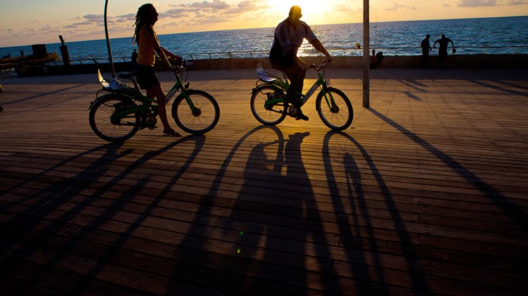 Cycling on the promenade in Tel Aviv.