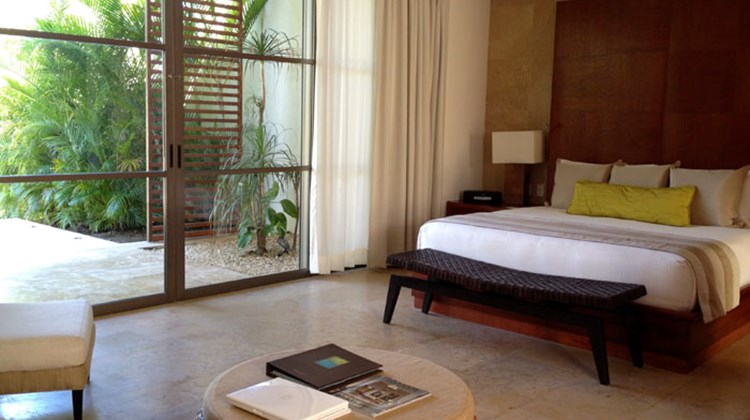 The bedroom of a Rosewood Mayakoba lagoon suite.