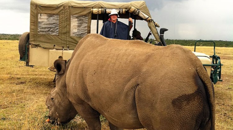 Ken Kiesnoski observes one of the endangered 11 southern white rhinoceroses and four northern white rhinoceroses being cared for at the Ol Pejeta Conservancy.