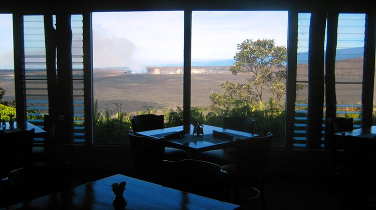 Breakfast in Volcano House's The Rim restaurant often offers the clearest views of Halemaumau Crater, which is currently home to a hidden lava lake spewing volcanic fumes.