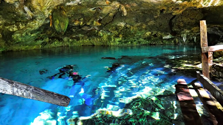 Snorkelers getting in at Dos Ojos, a popular snorkeling cenote and one used by Hidden Worlds.