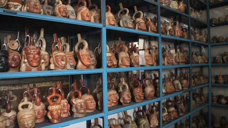 Hundreds of pre-Inca clay pots, shaped to represent human heads, fill shelves in Lima's Larco Museum.
