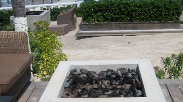 Fire pits scattered in the lounge areas around the pool are popular, especially at night for cuddling couples.