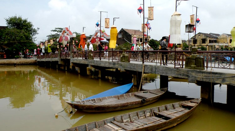 A bridge on the Thu Bon River in Hoi An, Vietnam; the town is a UNESCO World Heritage Site.