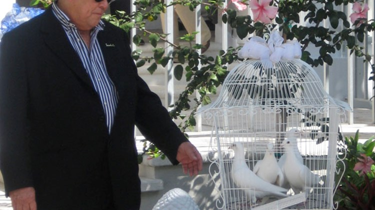 Chairman Butch Stewart releases white doves at opening ceremony of Balmoral Tower.