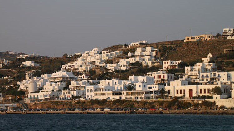 View of Mykonos houses and bay. The Greek island manages to preserve its charms despite the fact it sometimes fills up with very large numbers of tourists.